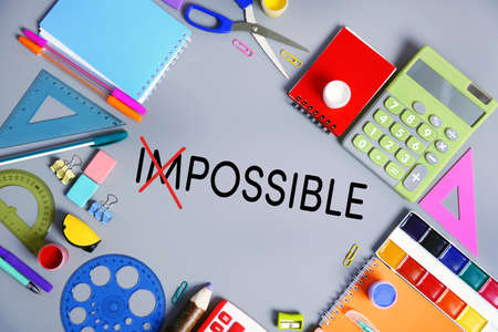 feasible: Word impossible transformed into possible and school supplies