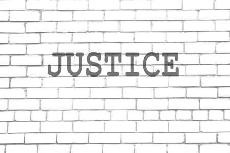 public transfer: Justice text on brick wall Stock Photo
