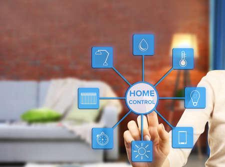 temperature controller: Woman Using smart home app on virtual screen. Smart home control concept.