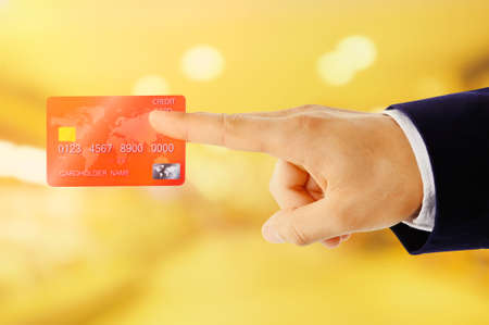 cash slips: Hand touch a credit card