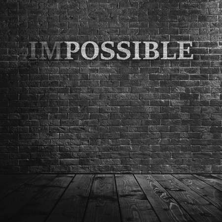 feasible: Word impossible transformed into possible on grey wall Stock Photo