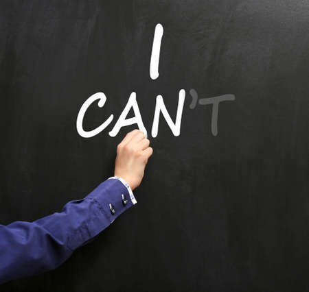transformed: Hand writing words I cant transformed into I can on blackboard Stock Photo