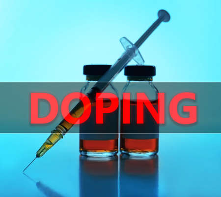 ampule: Stop doping concept. Medical ampule with syringe on blue background Stock Photo