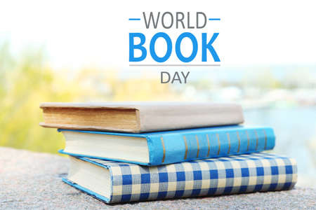 stacked books: Stacked books on bright background. World Book Day poster Stock Photo