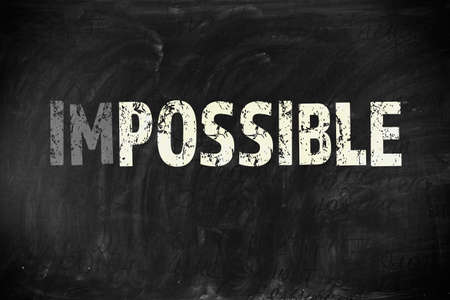 feasible: Word impossible transformed into possible on blackboard