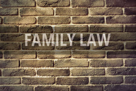 solicitor: Family Law text on brick wall
