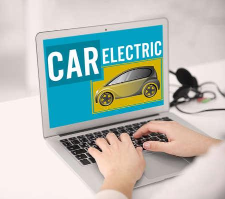 using laptop: Woman using laptop. Eco car concept