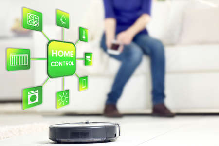 temperature controller: Using smart home app on phone. Smart home control concept. Stock Photo