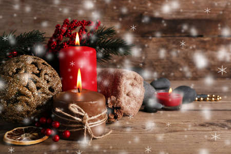 Christmas spa on wooden background with snow effect Stock Photo