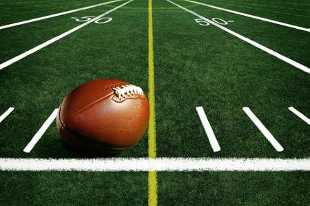 American football on football field background