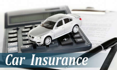 generic location: Car insurance concept. Tablet, calculator and toy car Stock Photo