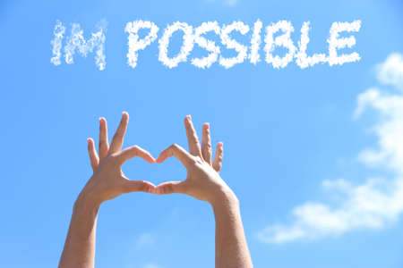 Word impossible transformed into possible on blue sky