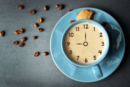 expires: Cup of coffee on gray background. Time concept