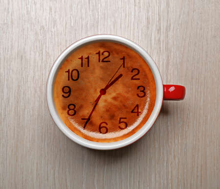 expires: Cup of coffee on light background, top view. Time concept