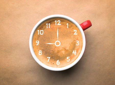 expires: Cup of coffee on beige background, top view. Time concept