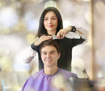 hairdresser: Professional hairdresser making stylish haircut Stock Photo