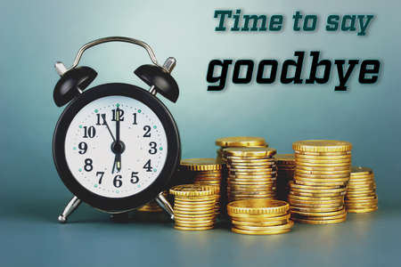 expires: Alarm clock with coins on grey background Stock Photo