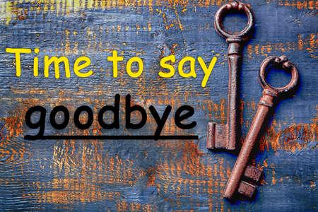 Old keys on blue scratched wooden background