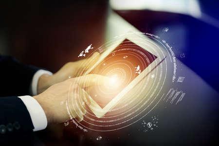 hight tech: Man using tablet against high tech background