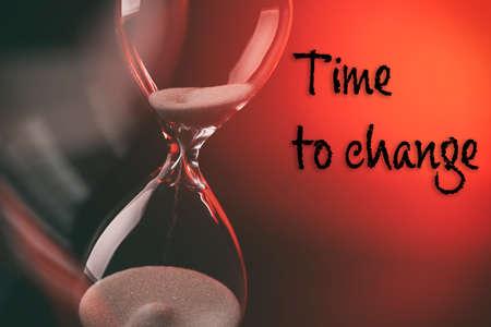 Hourglass on dark red background Stock Photo