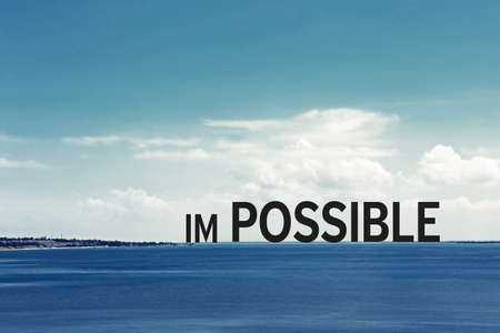 Word impossible transformed into possible on nature backgroung Stock Photo