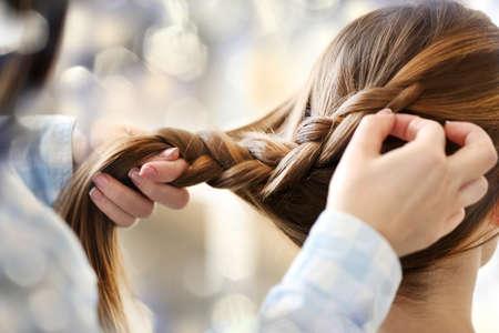 braids: Woman making braids