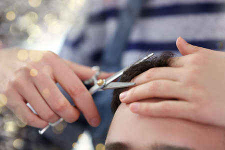 hairdresser: Professional hairdresser making man haircut Stock Photo