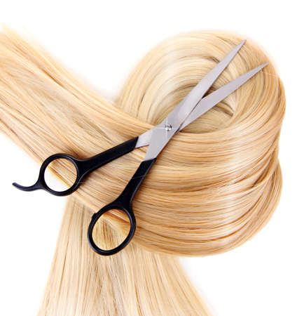 Long blond hair and scissors isolated on white Stock Photo