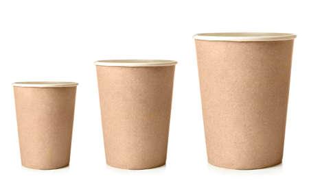 3 つの紙コップ白で隔離の異なるサイズ 写真素材