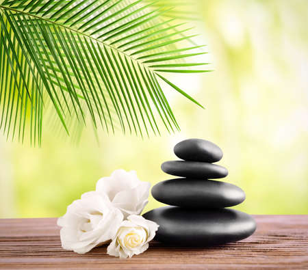 Black spa stones on light background