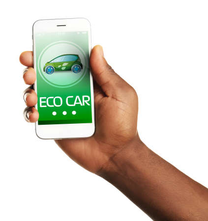 holding smart phone: Hand holding mobile smart phone, isolated on white. Eco car concept Stock Photo