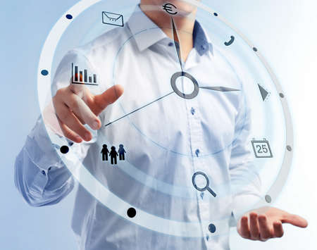 Businessman hand pushing time icon on virtual screen. Stock Photo