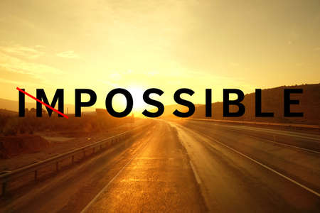 Changing the word impossible to possible on asphalt road