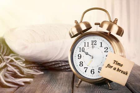 Alarm clock with sticker on bright background