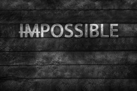transformed: Word impossible transformed into possible on grey wall Stock Photo