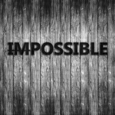 Word impossible transformed into possible on grey wall Stock Photo
