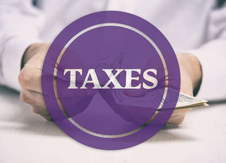 counting money: Taxes concept. Man counting money and making calculations Stock Photo