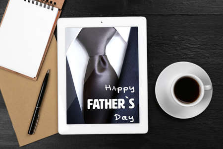 decorate notebook: Happy fathers day concept. Digital tablet with cup of coffee and notebook on wooden table, closeup