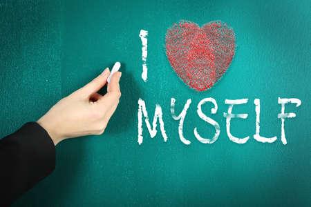egoistic: Love myself concept. Hand writing on blackboard in class room