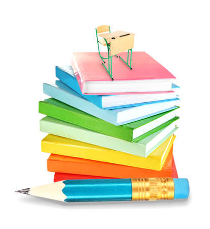 schooldesk: Little wooden desk and chair on stack of books and big pencil isolated on white Stock Photo