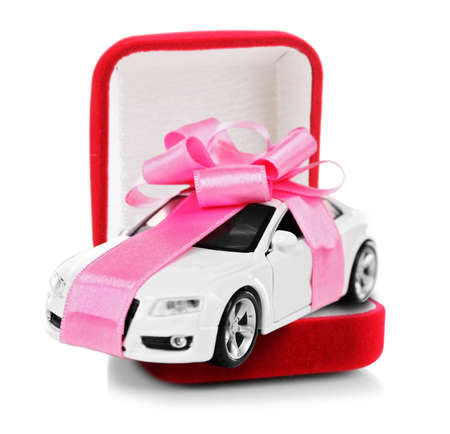 New car with pink bow as present in red jewelry box isolated on white Reklamní fotografie