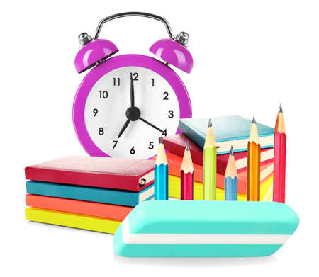pencil eraser: Colorful notebooks, pencil, eraser and alarm clock isolated on white