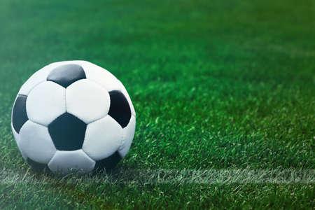 Soccer football field stadium and ball on green grass Stock Photo