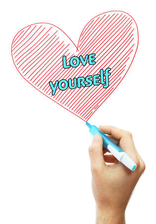 egoistic: Male hand with marker writing Love yourself Stock Photo