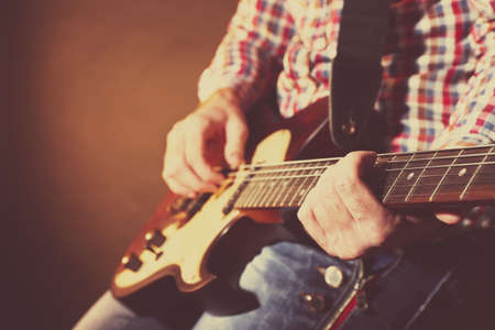 hand jamming: Young man playing on electric guitar