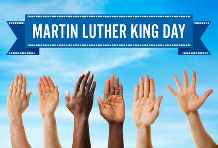 Martin Luther King Day. Different hands on blue sky background Standard-Bild