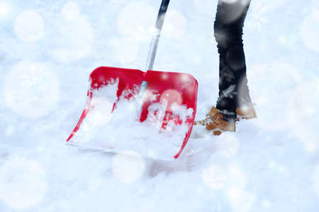 Man removing snow with a snow shovel. Snow effect Stock Photo