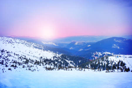 wintertime: Sunrise and snowy mountains in wintertime