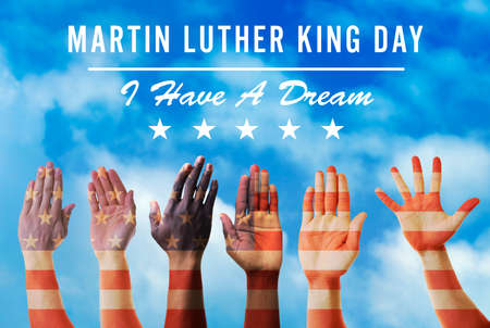 Martin Luther King Day. Different hands on blue sky background 스톡 콘텐츠