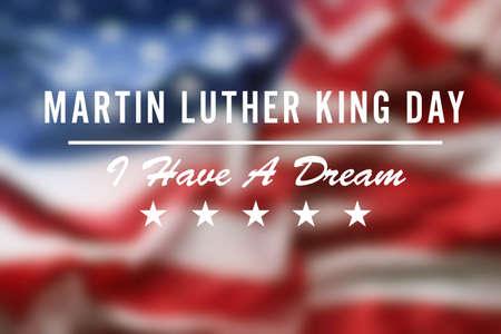 Martin Luther King Tag. Verschwommene Flagge der Vereinigten Staaten von Amerika